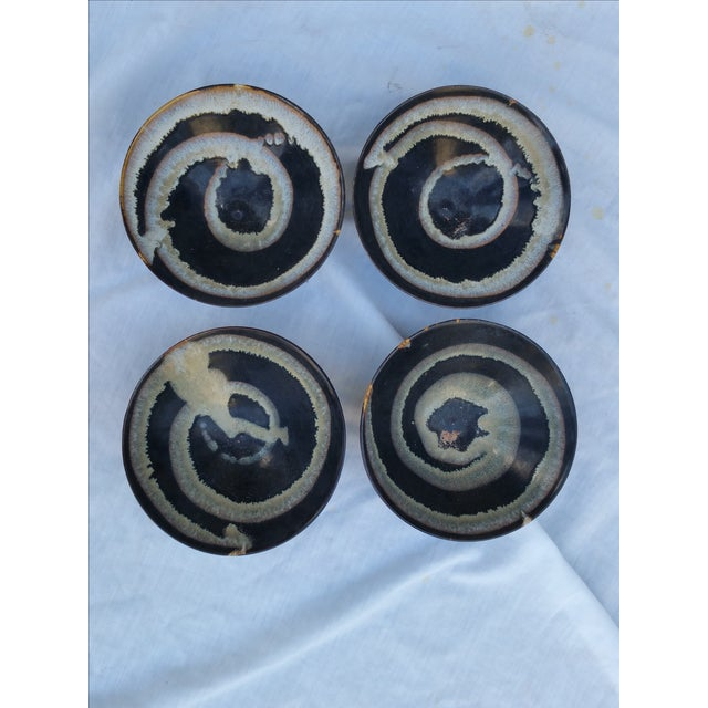 Set of four (4) wheel thrown pottery bowls with drippy mat glaze design. Feature blue and white swirl pattern. Bottom has...
