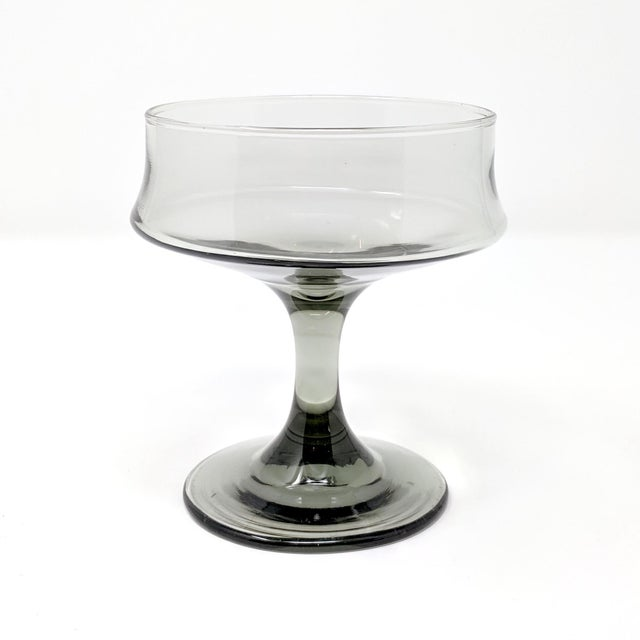 Set of six mid-century cocktail glasses in smoked glass. In excellent condition, these elegant vintage glasses are perfect...
