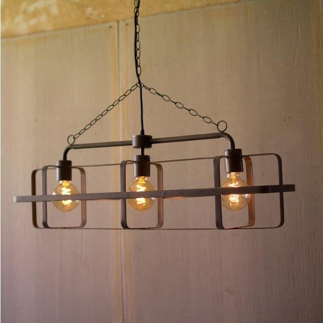 Modern industrial 3 light metal pendant. Flat metal bars welded into a simple and sturdy cage design. Chain length can be...