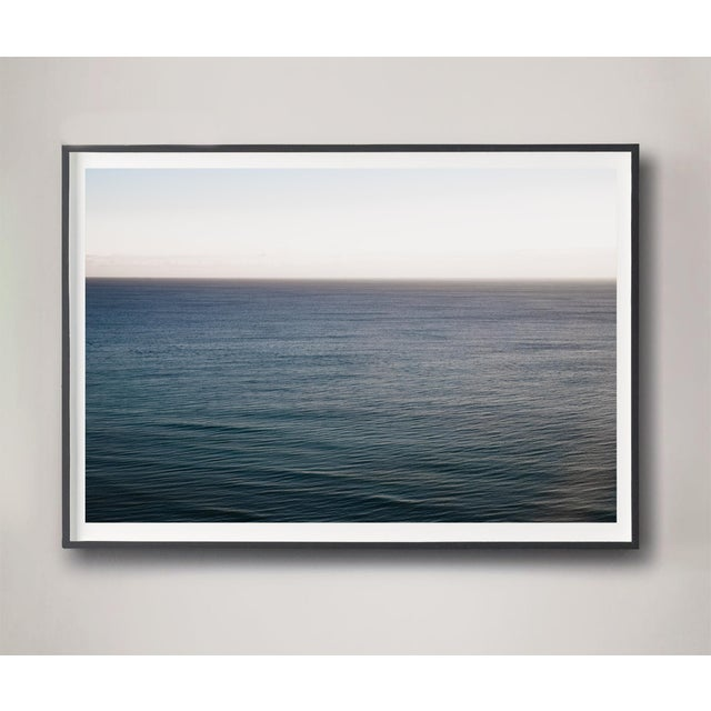 A high vantage point overlooking early morning Miami Beach captured in dense ocean hues. Archival photograph printed on...