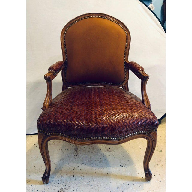 Brown suede and tweed leather bergère armchair by Brunschwig & Fils. This rarely ever sat in bergère armchair by...
