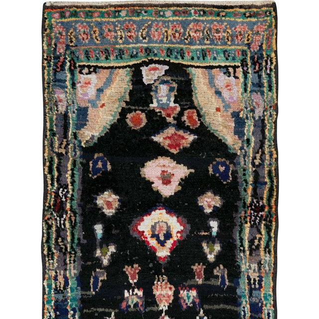 A vintage Persian Gabbeh rug from the mid-20th century. The word 'Gabbeh' in Persian (Farsi) means 'unclipped.' It is a...