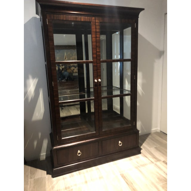 Brighton China Cabinet a part of Ethan Allen' s Modern Glamour Collection Beveled glass doors, 2 glass shelves, mirrored...