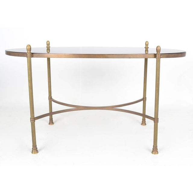 Fine quality table in nice petite size. Neoclassical design with fluted column legs topped with a black granite top. Solid...