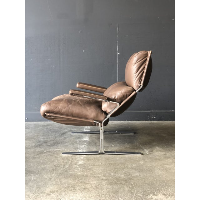 A Siesta lounge chair and matching ottoman designed by Ingmar Relling for Westnofa Furniture. Brown leather shows great...