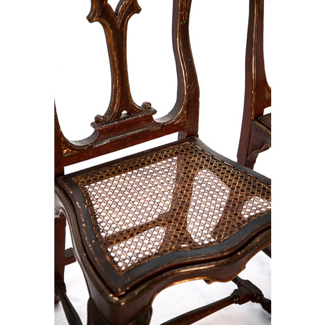 A pair of painted Portuguese Baroque side chairs with wickerwork seats. Ca. 1730. (2).