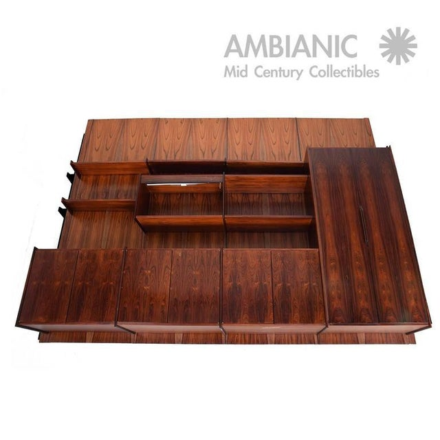 For your consideration a Brazilian rosewood credenza. Four bay system with multiple shelves and storage. Designed by Ib...