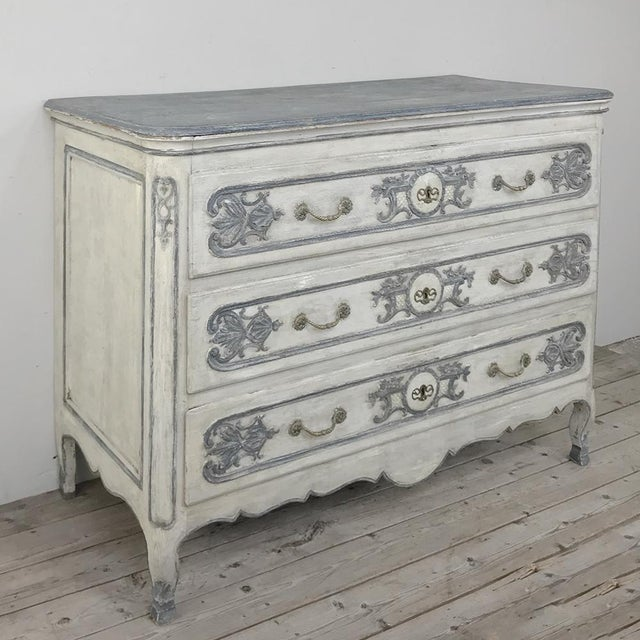 19th Century Country French Regence Painted Commode was painstakingly hand-crafted by talented rural artisans to reflect...