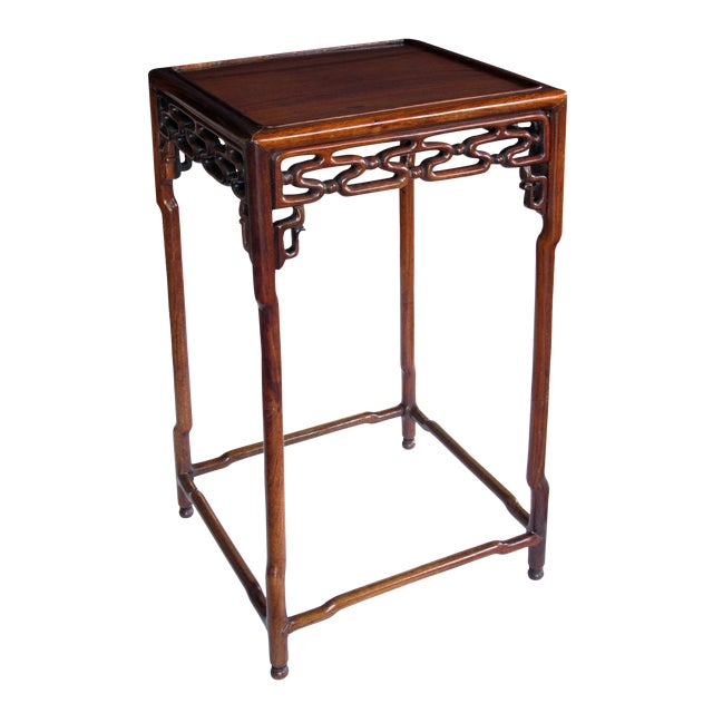 A richly patinated Chinese hongmu wood square side table with stylized openwork cloud-scroll apron and spandrels For Sale