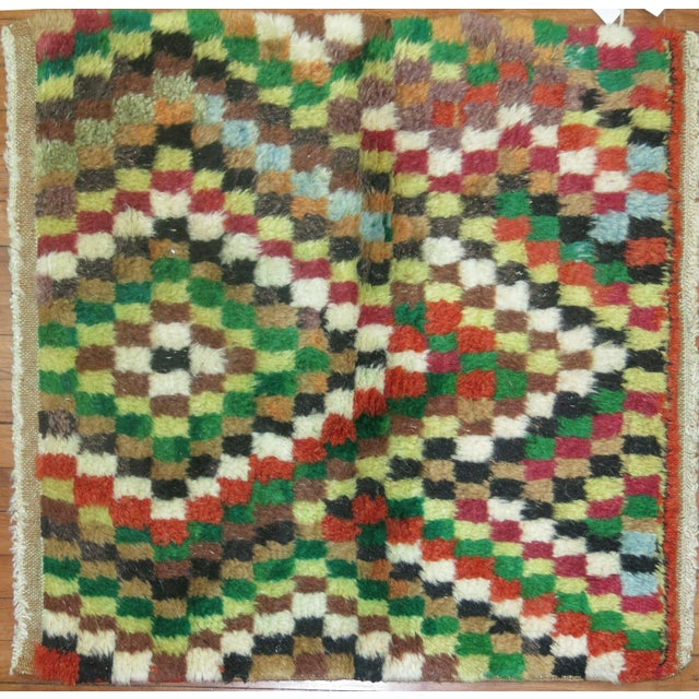 Perfectly plush, this Mid-Century Turkish rug features a pattern of a mosaic-style motifs.