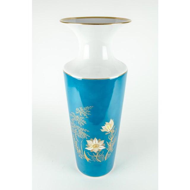 Very tall vintage bavarian porcelain turquoise color with gold design details vase / decorative piece. The piece / vase is...