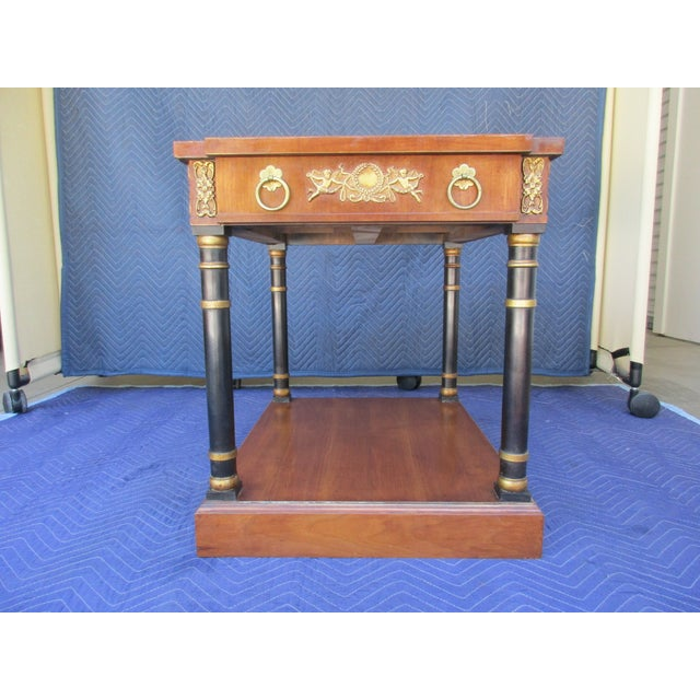 This beautiful side table by Fine Arts Furniture out of Grand Rapids, Michigan, is highly decorated with a Cherub motif...