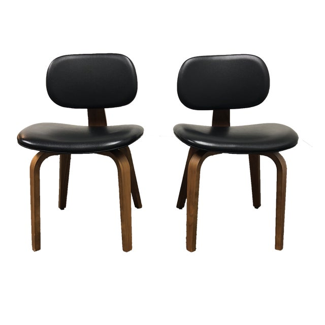 gus thompson black leather chairs a pair chairish