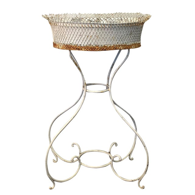Mid-19th century, an Arras Jardinière, a very elegant metal-wire painted planter stand made of wire and wrought iron,...