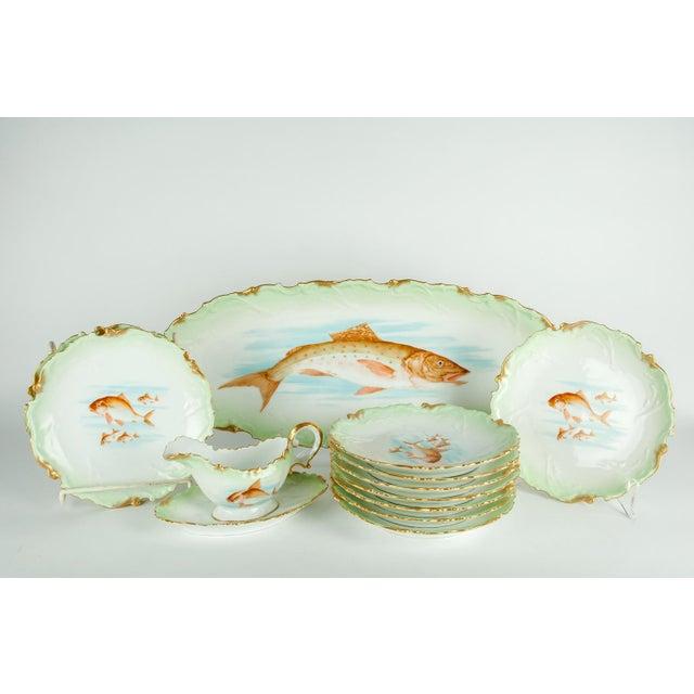 Antique Limoges porcelain with 22 K gold Victorian era hand painted 13 pieces fish serving set. each piece is in excellent...