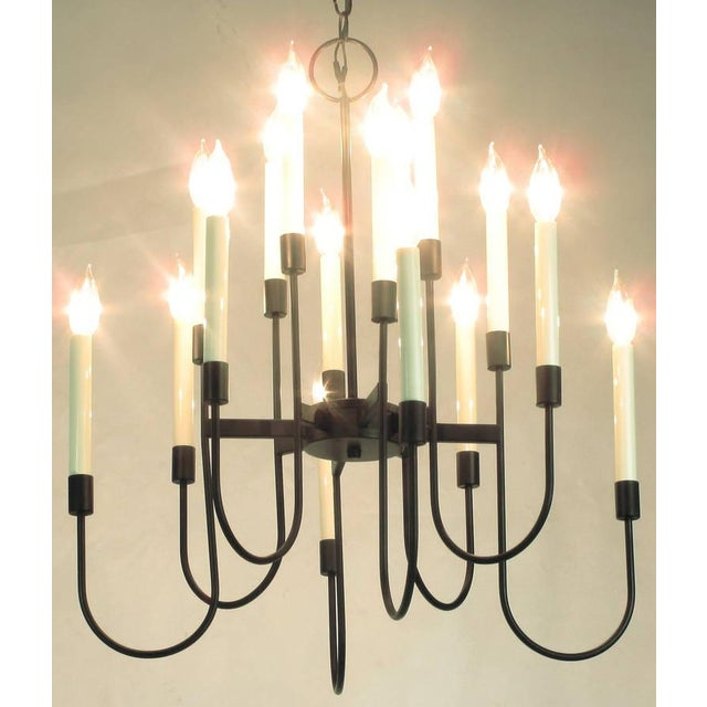 Elegant black lacquer sixteen-light chandelier by Lightolier. The design is often attributed to Tommi Parzinger. The...