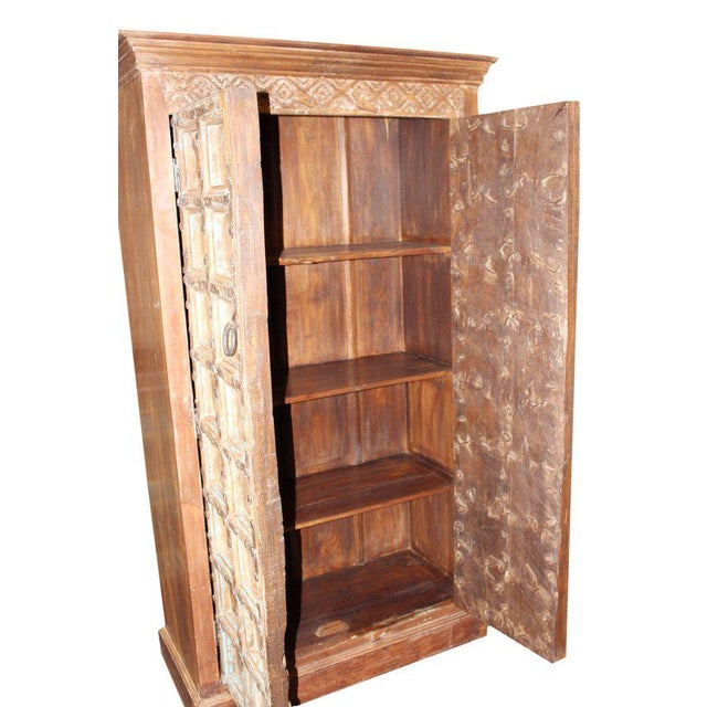 Indian antique hand carved wooden cabinet with front 2 door three shelves for plenty of storage, this is the perfect piece...