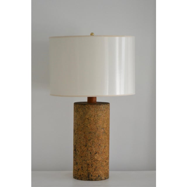 Stunning Mid-Century cylindrical form cork table lamp, circa 1960s - 1970s. This striking lamp is designed of ceramic...
