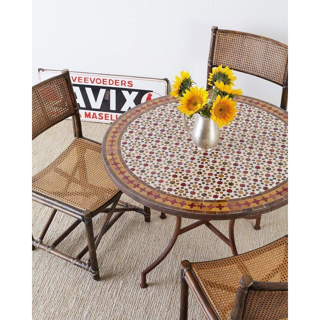 Fantastic Spanish dining table or garden table featuring a round stone top with Moroccan mosaic tile inlay. The...