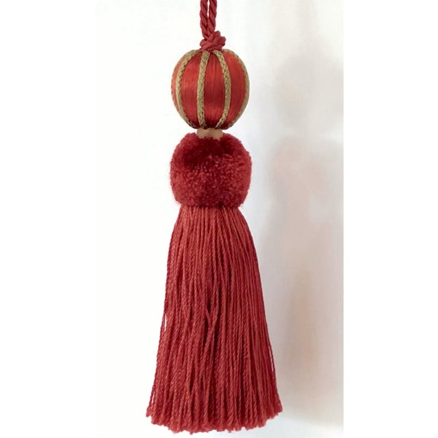 Red & olive-green beaded key tassel w twisted cord that creates the key loop. Soft gold colored glass bead separates the...