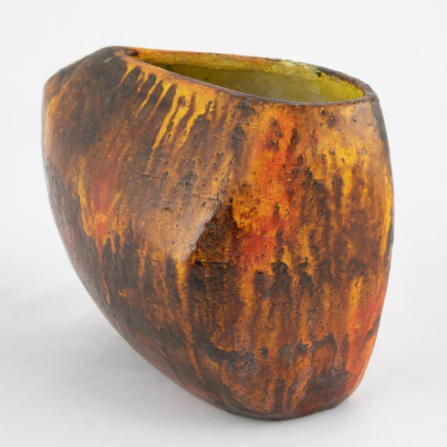 Very unusual hand-formed vase by Italian master Marcello Fantoni. This asymmetrical form features brown and orange drip...