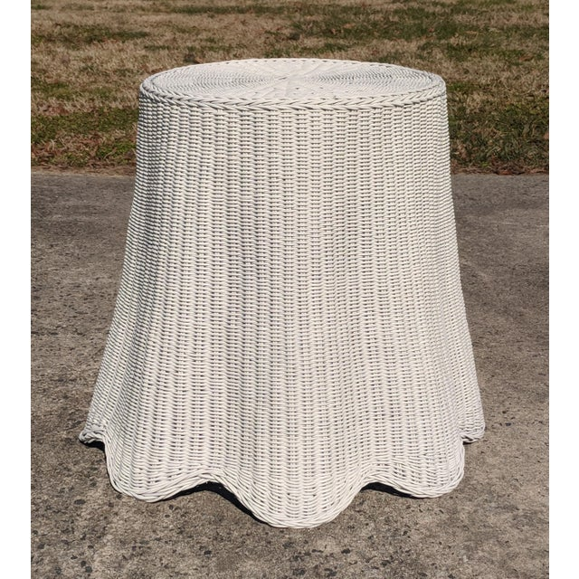 In the style of Celerie Kemble, this fantastic table is made of handwoven wicker painted white, and is meant to fool the...