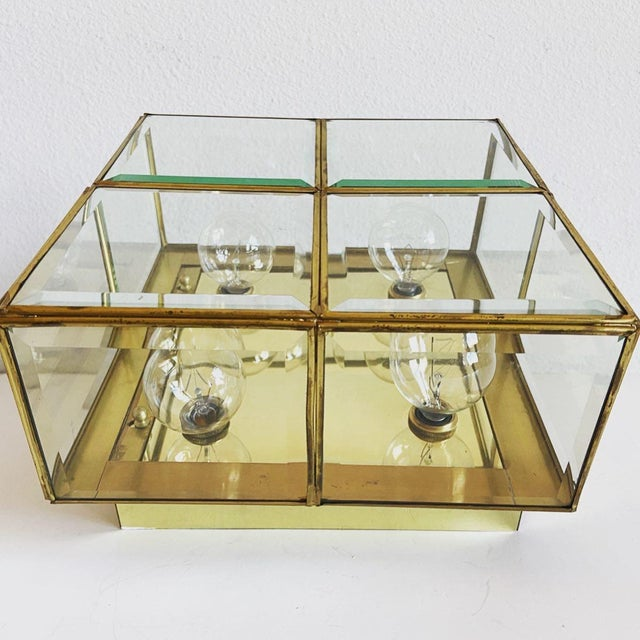 Sparkling 1950s Lightolier jewel box flush or wall mount light featuring a square polished brass frame with four lights...