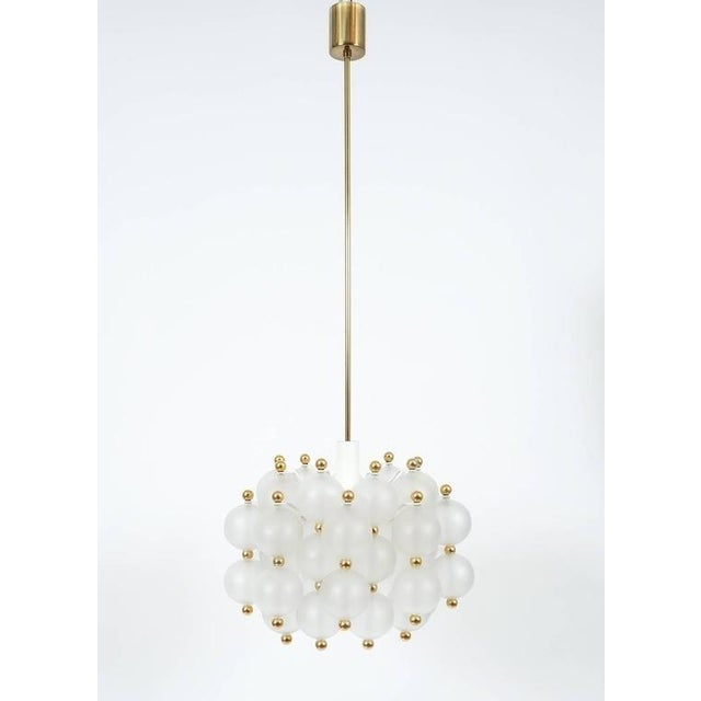 Glass chandelier lamp in the style of Seguso, circa 1980. Beautiful and large chandelier with a multitude of smooth...