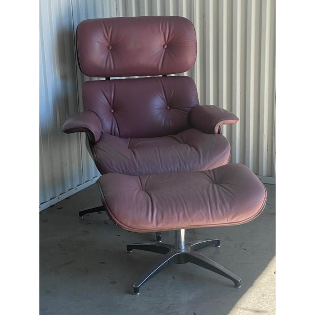 Amazing chair and ottoman done in the manner of Charles Eames for Herman Miller. The pieces are both covered in the most...