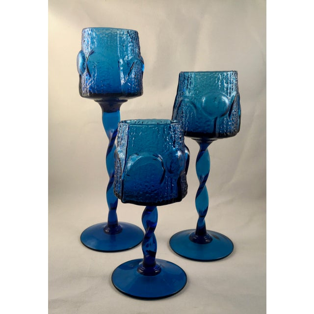 Offering a stunning set of three Stelvia Glass sapphire blue glass votive candle holders in graduated heights. These...