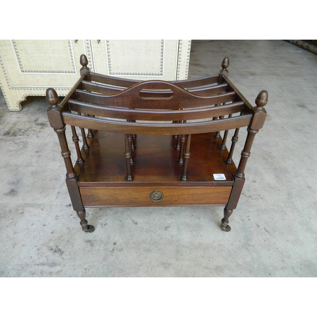 A very fine quality Regency period Mahogany four division Canterbury, having a single drawer and raised on turned tapering...