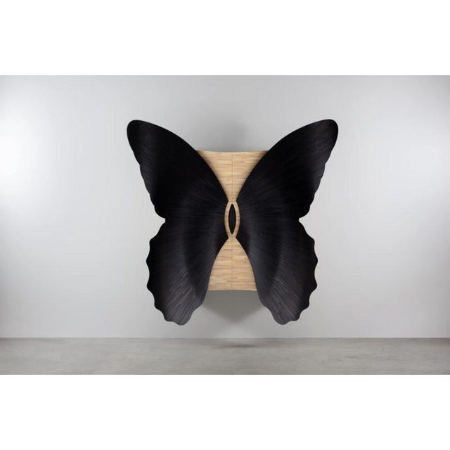 Jean-Luc Le Mounier's latest work, the Papillon Cabinet is assertive in form with two grand curved wings facing the...