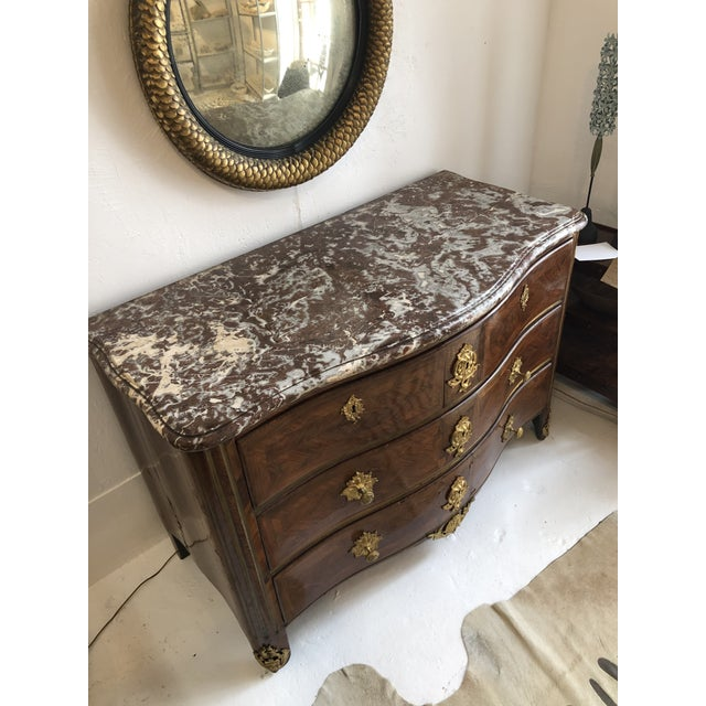 Commode, type of furniture resembling the English chest of drawers, in use in France in the late 17th century. Most...