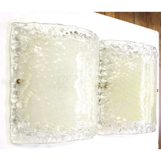 Italian Modern pair of sconces made in Murano glass during the mid-late 20th century. The pair is in great vintage...