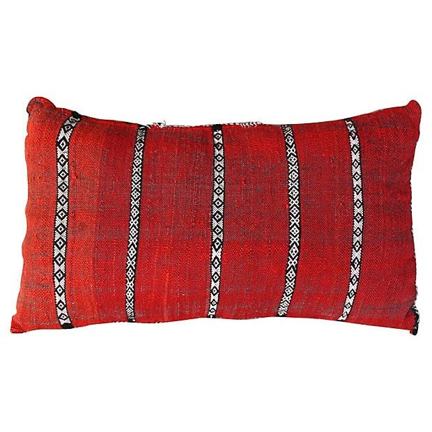 This fun and bright handwoven Moroccan Berber pillow sham has an elaborate diamond pattern and a lively assortment of...