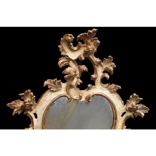 Rococo A Fanciful Venetian Rococo Revival Ivory Painted and Parcel-Gilt Cartouche-Shaped Miror For Sale - Image 3 of 5