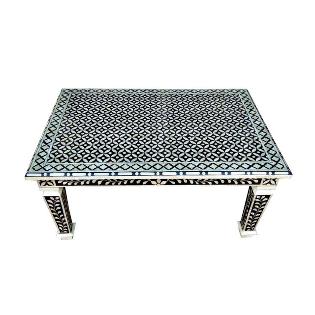 The beautiful combination of Floral & Geometric pattern of our Hand Cut Bone Inlay coffee table design makes a great focal...