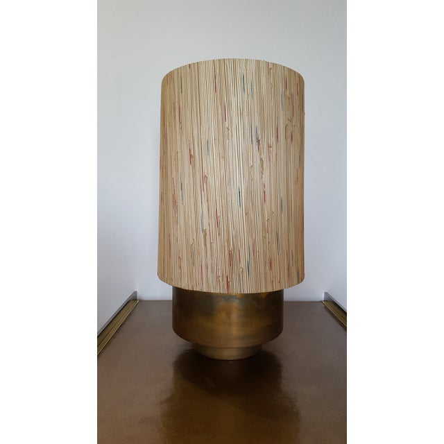 New modern brass table lamp with custom grasscloth shade by Paul Marra. Currently a pair available, or by order. The...