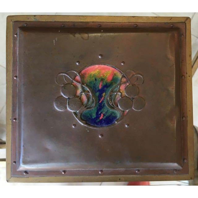 Copper box with enamel and brass overlay in Arts and Crafts/ Art Nouveau style. The top and sides are chased with whiplash...