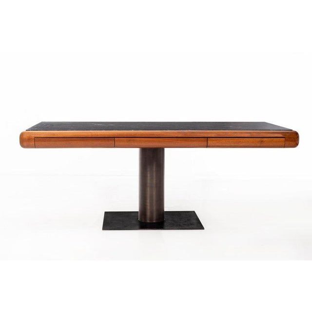 Pedestal desk, teakwood top with radius edges, 3 pencil drawers, and an inlaid verde cavendish marble surface, bronze...