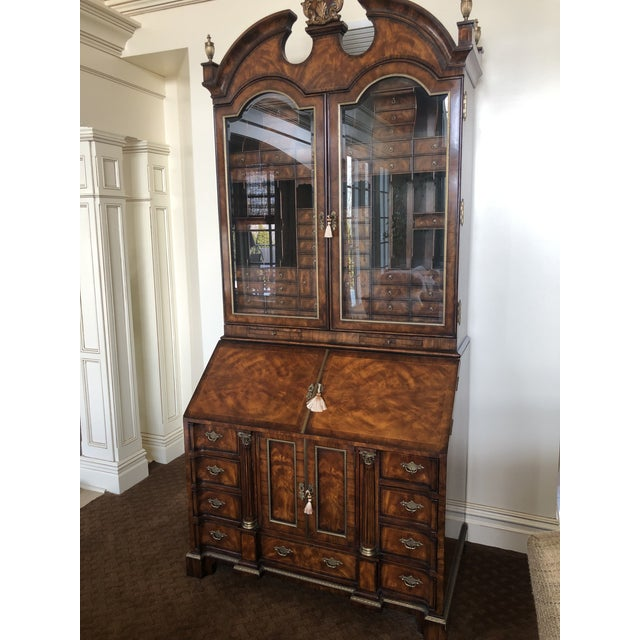 Beautifully crafted mahogany and rosewood cabinet with 45 drawers and 19 pigeon holes. Opens to reveal a leather inset...
