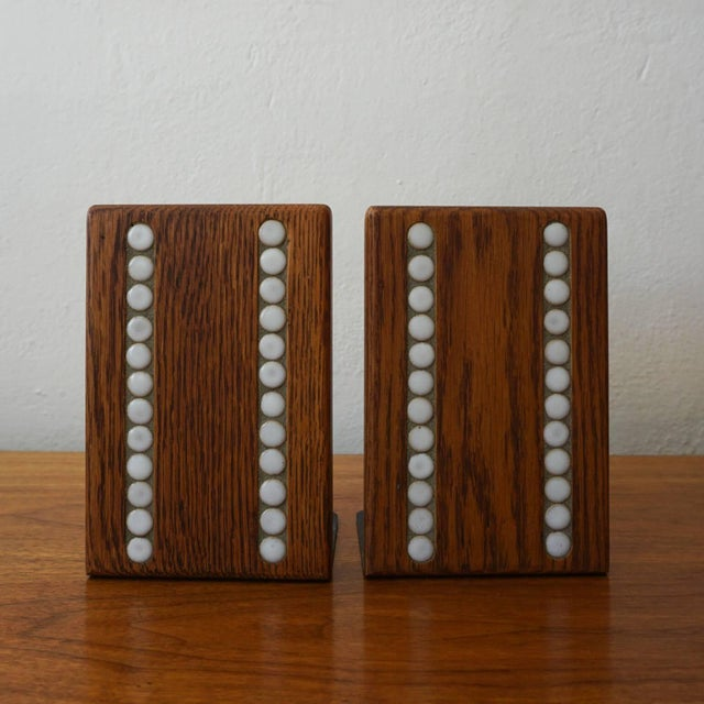 Bookends with ceramic tile by Jane and Gordon Martz for their company, Marshall Studios.
