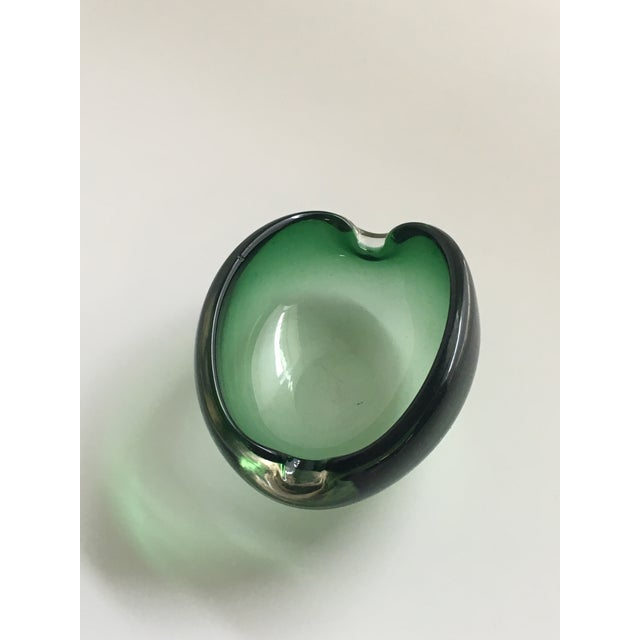 A fantastic emerald green Murano art glass dish by Alfredo Barbini. I love the color of this piece, it would add a pop of...