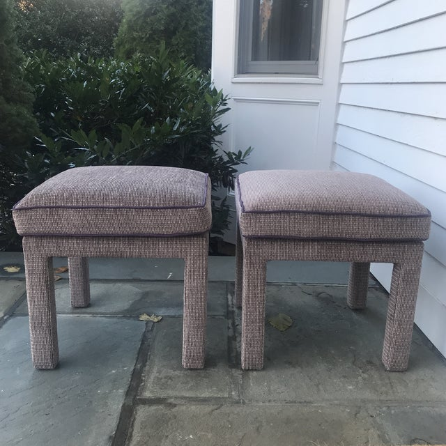 A pair of vintage upholstered parsons stalls. Textured dusky purple fabric with contrasting welting. Mod and stylish- with...