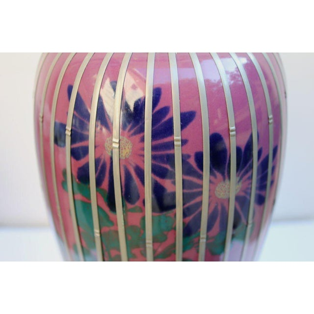 A very pretty Japanese hand painted pottery vase with a basket weave pattern silver-plate overlay.