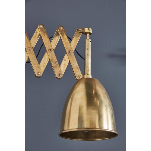 """A pair of Italian brass extendable library lamps with a warm and rich patina. Dimensions: Expanded 36"""" Dimensions: Closed..."""