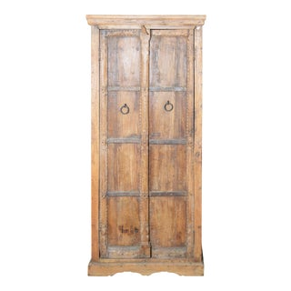 Indian Vintage Wooden Armoire with Metal Braces and Hand-Carved Decor For Sale