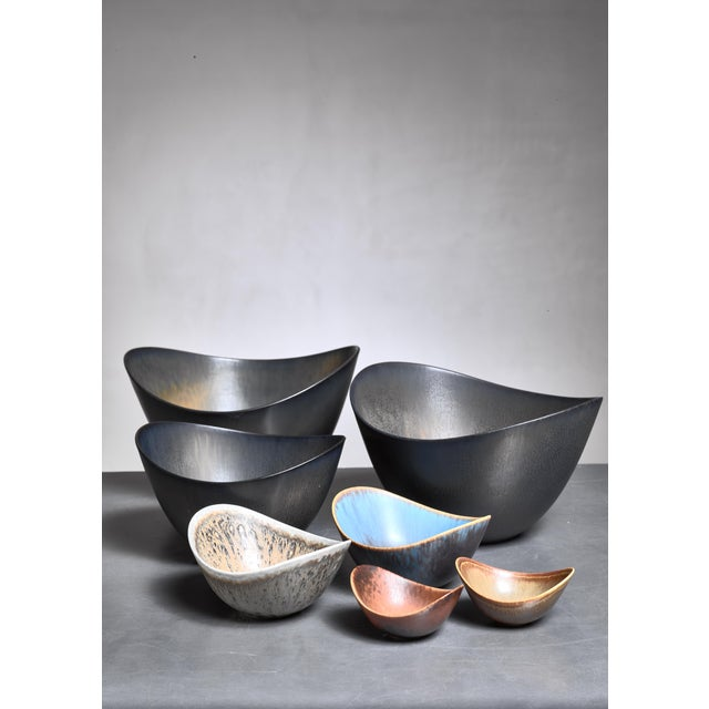 A set of seven Gunnar Nylund ceramic bowls for Rörstrand, Sweden. The measurements stated are of the two largest bowls....