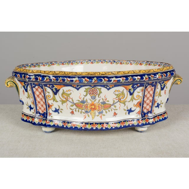 A 19th century French faience jardiniere, or planter, from Desvres by Fourmaintraux Freres. Hand-painted in typical floral...