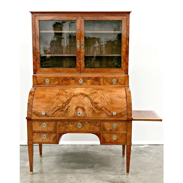 An exceptional Louis XVI period bureau à cylindre, or cylinder desk with bookcase, giving you a glimpse of the beauty of...